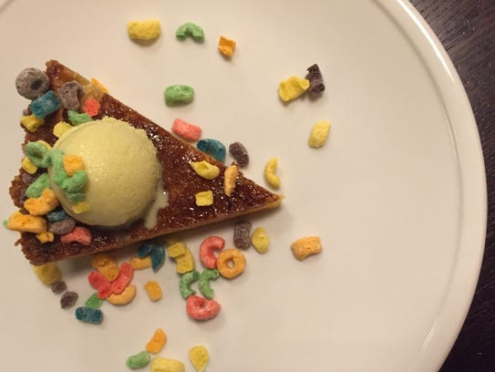 A slice of shugga pie with cereal milk ice cream at