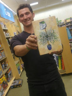 """AJ Smith spent three years writing and self-publishing his new book, """"Growth."""" Central Jersey is almost like another character in the book, as the main characters find themselves at the Raritan Valley Community College theater, the Rock Avenue jug handle on Route 22 and the Somerset Hotel in Somerville."""