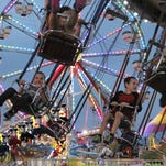 Jack Hardman/The News-PressChildren ride the swings at the Southwest Florida and Lee County Fair on Thursday night at the Lee County Civic Center. Children ride the swings at the Southwest Florida and Lee County Fair on Thursday night at the Lee County Civic Center.