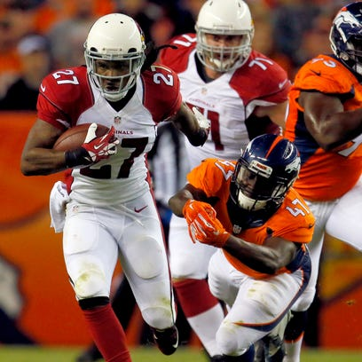 Arizona Cardinals running back Chris Johnson escapes