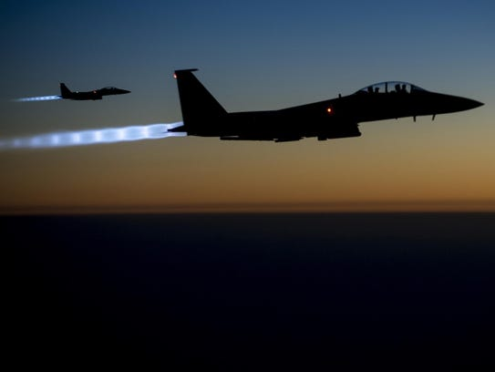 A pair of U.S. Air Force F-15E Strike Eagles fly over