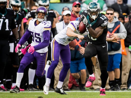 Eagles returner Josh Huff beats the kicker on his way to the end zone.