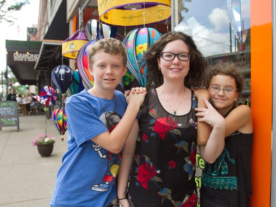 Toyology employee Rebecca Gremore poses with her children