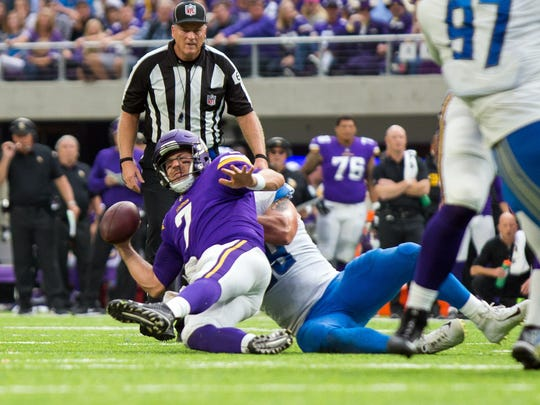 Oct 1, 2017; Minneapolis, MN, USA; Lions defensive end Anthony Zettel sacks Vikings quarterback Case Keenum in the third quarter at U.S. Bank Stadium.
