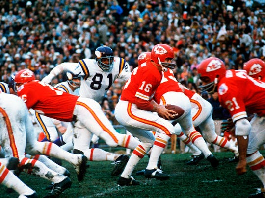 FILE - In this Jan. 11, 1970, file photo, Kansas City Chiefs quarterback Len Dawson (16) turns around to hand the ball off to running back Mike Garrett (21) during the Super Bowl IV football game in New Orleans. For the second year in a row, a heavily favored NFL team lost to a supposedly weaker AFL opponent in pro football's championship game, when the Vikings fell to the Chiefs. (AP Photo/File)
