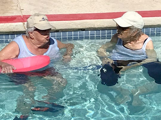 Toni Duschene, left, and Barbara Agte experience the warm water jets in the therapy pool.