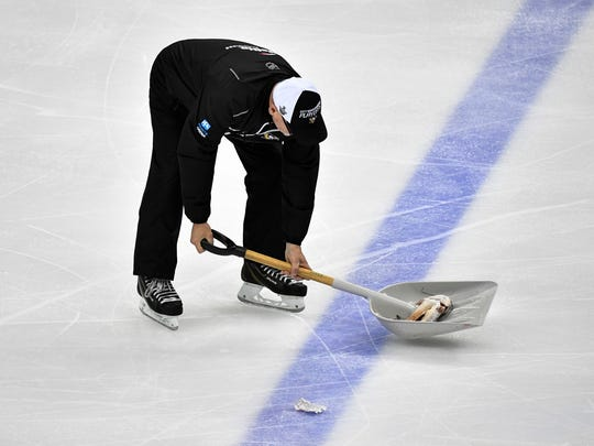 A catfish is scooped off the ice after a fan threw