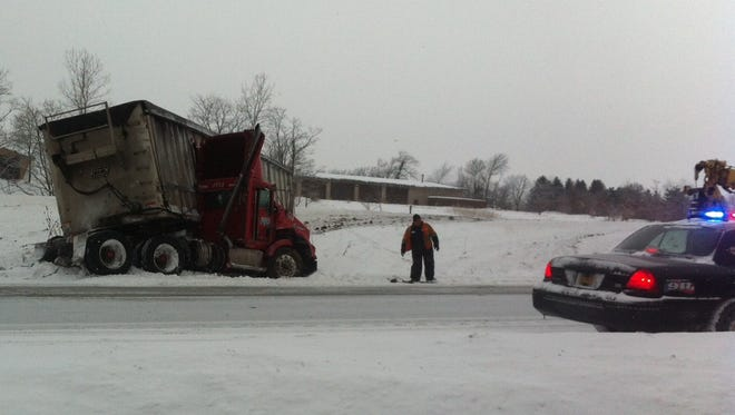 A jackknifed truck closed northbound traffic on I-390 Tuesday.