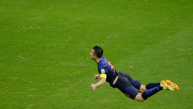Netherlands' Robin van Persie heads the ball to score during the group B World Cup soccer match between Spain and the Netherlands at the Arena Ponte Nova in Salvador, Brazil, Friday, June 13, 2014.  (AP Photo/Christophe Ena) ORG XMIT: WCEM154