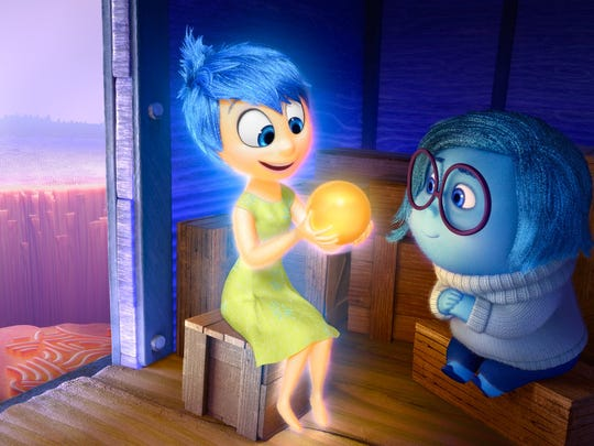 """Joy (voice of Amy Poehler) and Sadness (voice of Phyllis Smith) catch a ride on the Train of Thought in Disney/Pixar's """"Inside Out."""""""