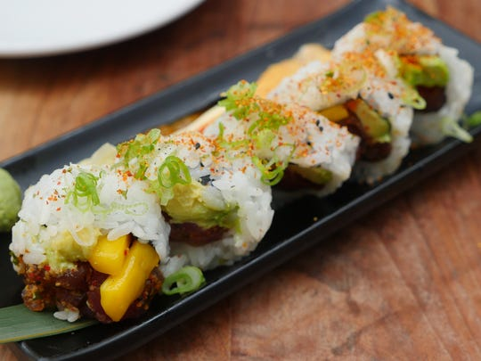 The Obligatory Spicy Tuna roll at Townhouse Detroit features  tuna, avocado, mango, pickled burdock, scallion, masago and sesame.