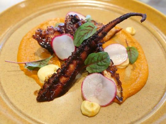 The octopus a la plancha, with spicy romesco, saffron aioli, black garlic, sorrel and radish at Mabel Gray in Hazel Park.