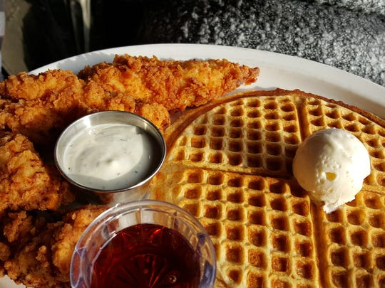 """The """"Tender Love,"""" three chicken tenders and a waffle. This is at Kuzzo's Chicken & Waffles on Livernois in Detroit."""