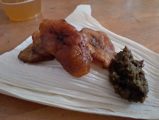 A snack of dodo (grilled plantain) with ayamase (a