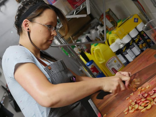 Mabel Gray pastry chef Kristina Conger chops rhubarb