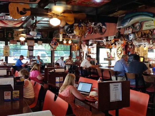 Patrons dine at Buffalo Chips restaurant on Old 41 Road in Bonita Springs on Thursday, Aug. 18.