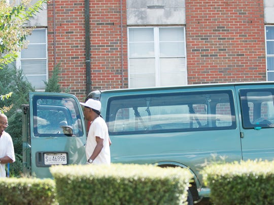 Workers currently serving time work to clean an occupied female dorm on Friday, Sept. 16, 2016, at Alabama State University in Montgomery, Ala.