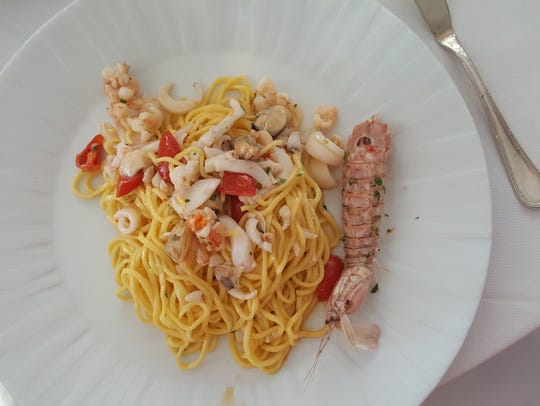 Seafood chitarra, a traditional Abruzzese pasta, from