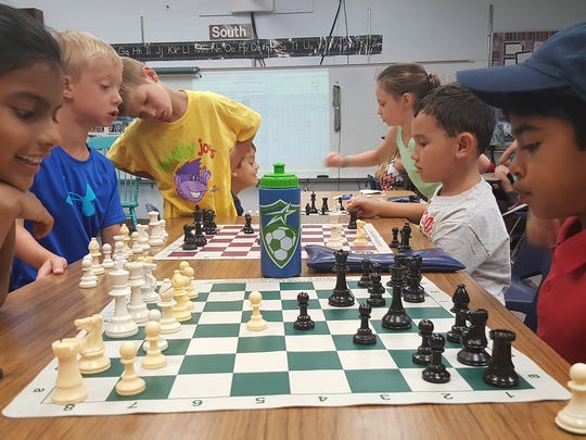 Students play chess, one of many classes offered during