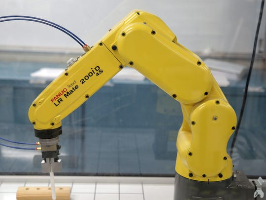 A FANUC robot at Truckee Meadows Community College's William N. Pennington Applied Technology Center. The robot is used to train people who want to work at the Tesla Gigafactory.