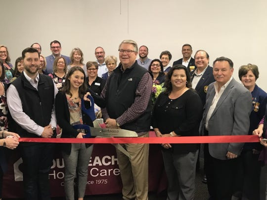 Members of the Concho Carde and San Angelo City Councilman Harry Thomas helped the staff at Outreach Health Services, 17 S. Chadbourne St., Ste. 500, celebrate the company's opening with a ribbon cutting Feb. 1. Outreach Health Services provides home care for those in need because of age or ailment.
