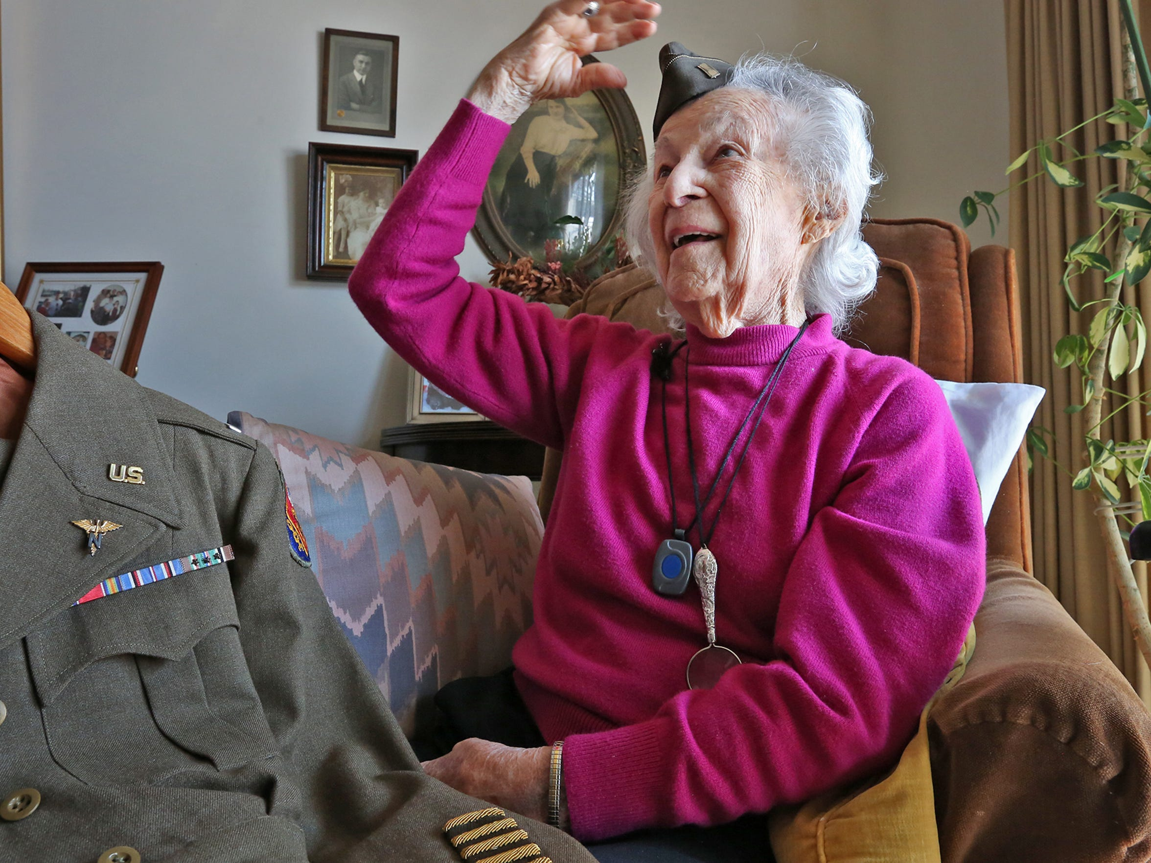 "Marian ""Nan"" Somes laughs when she tries on her tiny World War II uniform hat, Thursday, Feb. 7, 2018.  The 101-year-old World War II veteran was a combat nurse and one of the ""Angels of Anzio,"" having been in Anzio during the Battle of Anzio."