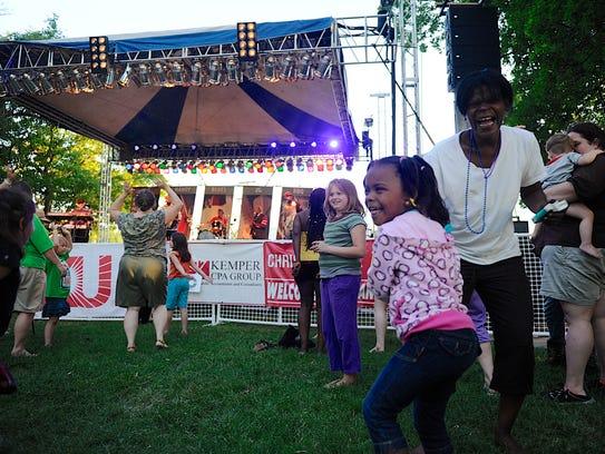 Jalayah Gant, 5, dances with her grandmother Nicole
