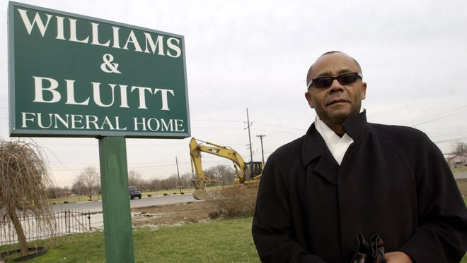 Nathan Bluitt Jr. is shown in 2007, standing in front of the old sign for the Williams and Bluitt Funeral home on the corner of 25th Street and Dr. Andrew J. Brown Ave., which was destroyed in a fire in 2006.