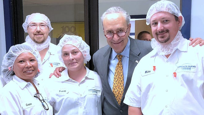 U.S. Sen. Charles Schumer joins employees of the Upstate Foods factory in Campbell on Thursday.
