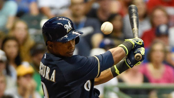 Milwaukee Brewers shortstop Jean Segura (9) grounds out to Philadelphia Phillies pitcher Cole Hamels (not pictured) in the third inning at Miller Park.