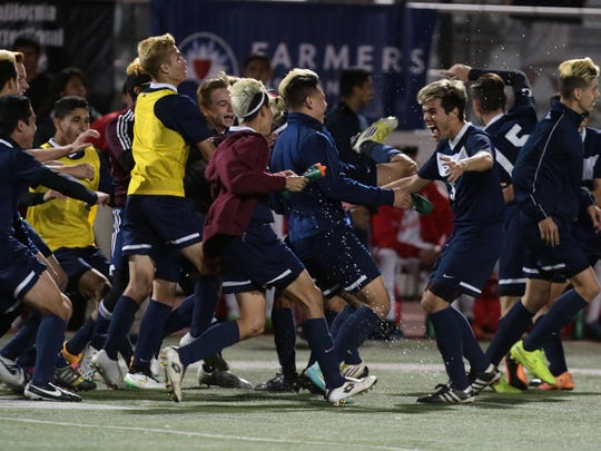 La Quinta celebrate its 3-2 win over Santa Ana for the CIF Southern Section Division 2 boys soccer championship title on Friday in Corona.