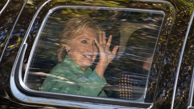 Democratic presidential candidate Hillary Clinton waves as she arrives for a fundraiser at the home Justin Timberlake and Jessica Biel in Los Angeles, Aug. 23, 2016.