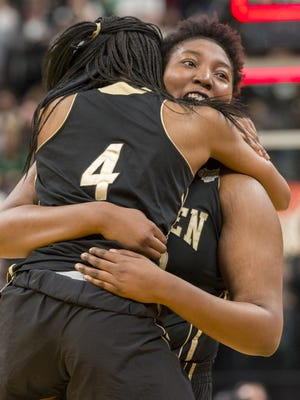 Warren Central High School junior center Cydni Dodd (50) and sophomore center Alaysia Davis (4) after winning the 43rd Annual IHSAA Girls Basketball State Finals class 4A championship game against Zionsville High School, Saturday, February 24, 2018, at Bankers Life Fieldhouse in Indianapolis. Warren Central won 50-46.