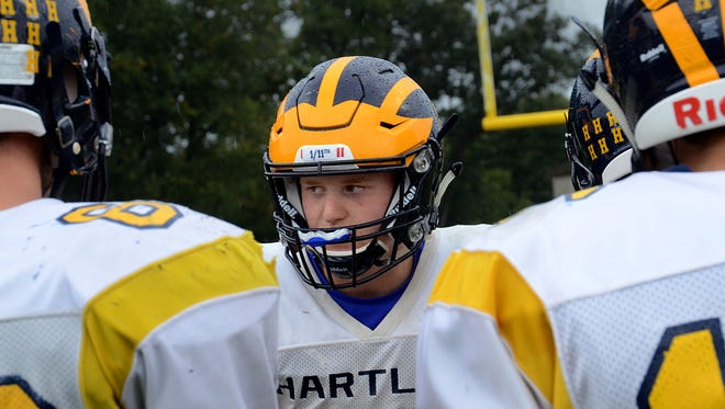 Freshman quarterback Zach Trainor led Hartland to an overtime victory at Westland John Glenn in his high school debut.