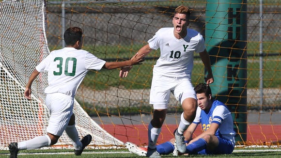 Yorktown's Besem Bucpapa(10) celebrates his first half goal with teammate Jorge Torres-Solari (30) during game against Mahopac at Yorktown High School Oct. 20, 2017.