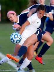 Siegel's Kirsten Wojciechowski (1) wraps her body around