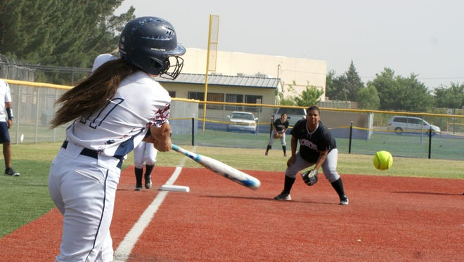 Junior Lady Cat Valerie Lopez puts the ball in play during Tuesday's District 3-5A double-header sweep over the visiting Chaparral high Lobos at E.J. Hooten Park. Lopez banged out two hits, drove home two runs and scored four times.