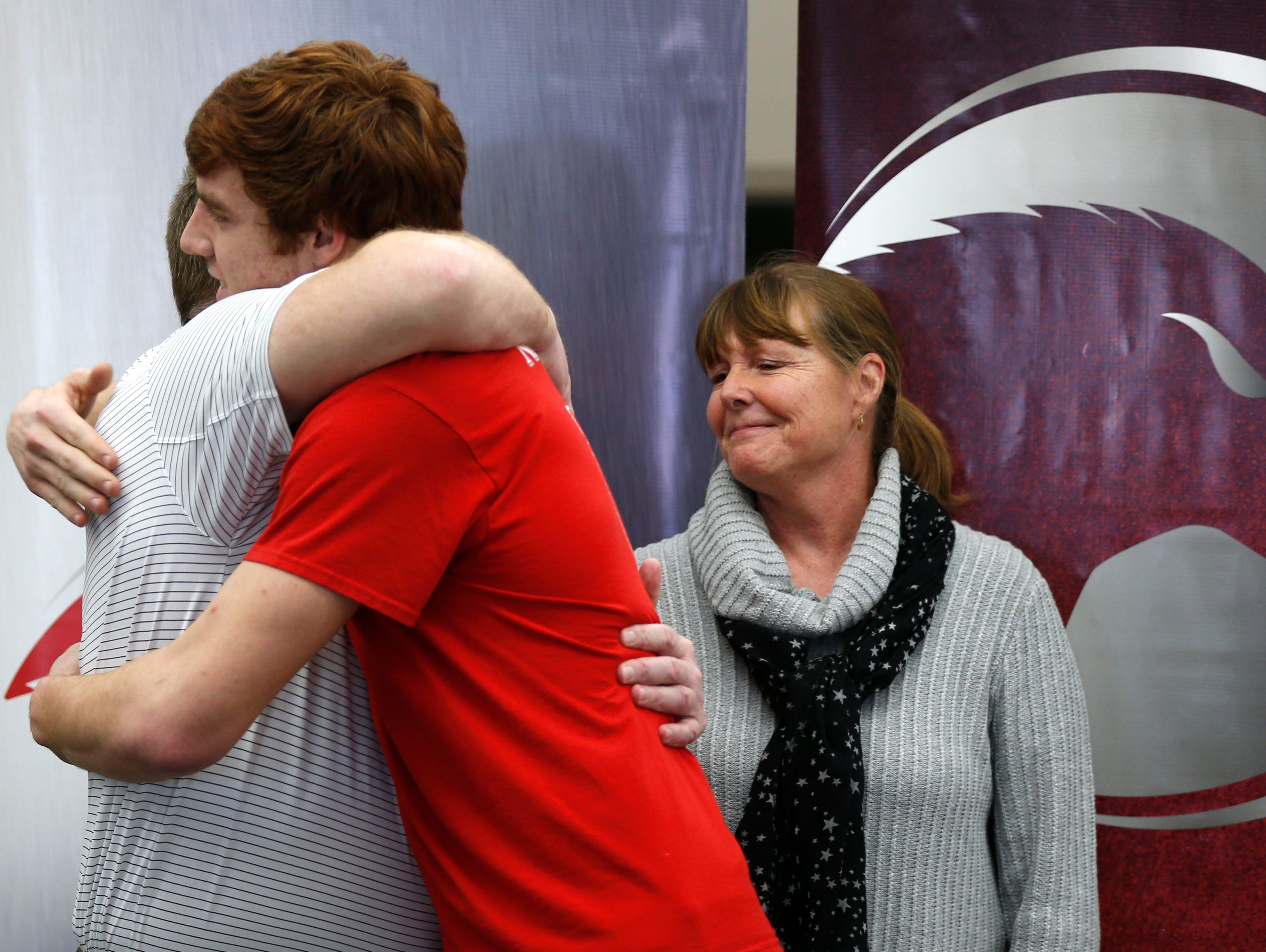 Nixa High School senior Chase Allen hugs his dad, former Missouri State football coach Terry Allen, after a press conference announcing his decision to play football at Iowa State on Friday, Jan. 29, 2016. Allen chose Iowa State over Michigan, Nebraska and 16 other NCAA Division I teams.