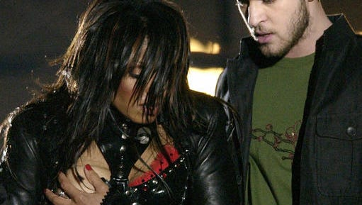 FILE - In this Sunday Feb. 1, 2004, file photo, entertainer Janet Jackson, left, covers her breast after her outfit came undone during the half time performance with Justin Timberlake at Super Bowl XXXVIII in Houston. Jackson's wardrobe malfunction is the indelible memory of the last Super Bowl in Houston, overshadowing a thrilling win by the New England Patriots in 2004 and forever changing how the NFL handles halftime performances.