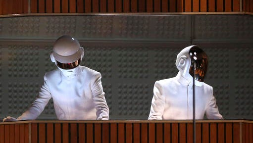 FILE - In this Sunday, Jan. 26, 2014, file photo, Thomas Bangalter, left, and Guy-Manuel de Homem-Christo of Daft Punk perform at the 56th annual Grammy Awards at Staples Center in Los Angeles. The Weeknd will team up for a performance with Daft Punk at the Grammy Awards on Feb. 12, 2017. The collaboration between the singer and the electronic music duo is one of a number of pairings announced Tuesday, Jan. 31, 2017.