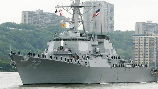 FILE - In this May 26, 2004 file photo, the USS Mahan, a guided-missile destroyer, moves up the Hudson River in New York during Fleet Week. A U.S. Navy guided-missile destroyer fired a warning flare toward an Iranian Revolutionary Guard vessel coming near it in the Persian Gulf, an American official said Wednesday, the latest tense naval encounter between the two countries.