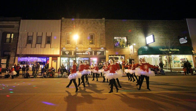 The holiday season kicked-off in Marshfield on Thursday evening when Main Street Marshfield held their annual  Holiday Parade down Central Avenue on November 15, 2012. Pictured, dancers from the Main Street Conservatory of Dance perform numbers from The Nutcracker as they travel down Central Avenue.