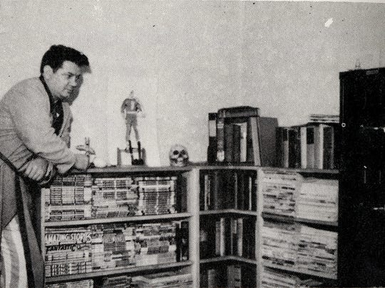 Otto Binder standing near some shelves in his office just after he and his wife Ione moved into the home in 1944. Binder, a Midwesterner, moved here to be closer to his brother, Jack, who had established a comic book art studio here.