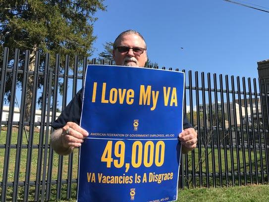 Veteran and VA employee Paul Stone rallies for more