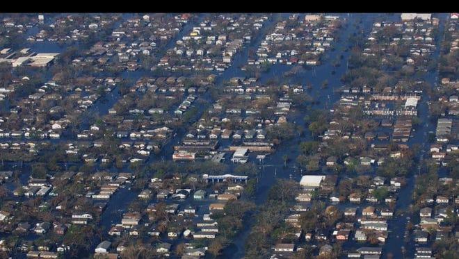 A neighborhood underwater in New Orleans after Hurricane Katrina in 2015.