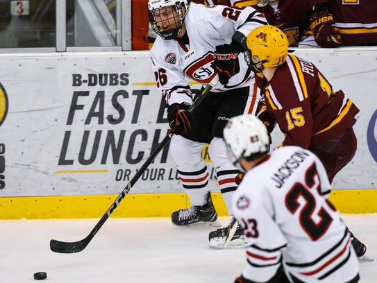 St. Cloud State's Easton Brodzinski makes a pass past