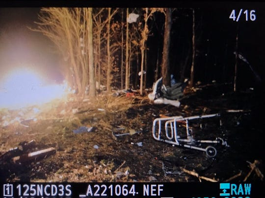 The remains of what appears to have been a house are seen on County Road 1000 just outside Poseyville early Wednesday morning.