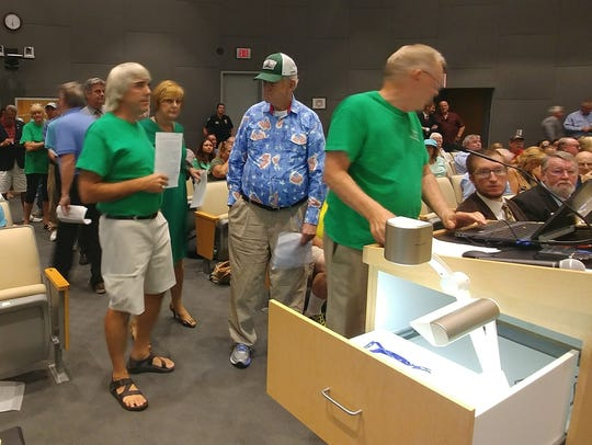 Community members opposing a land-use change at The