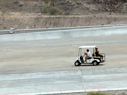 A golf cart shuttles visitors from the parking lot to the dock at Callville Bay Resort & Marina in Lake Mead on May 23. The marina has started offering the service as the falling water level has made for a longer walk down the hill.