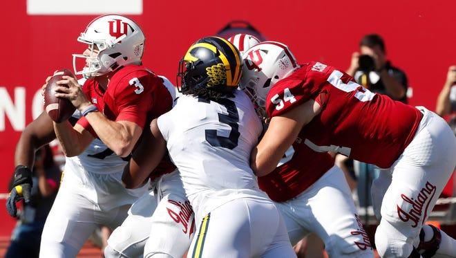 Michigan Wolverines defensive linemen Rashan Gary (3) attempts to tackle Indiana Hoosiers quarterback Peyton Ramsey (3) at Memorial Stadium.